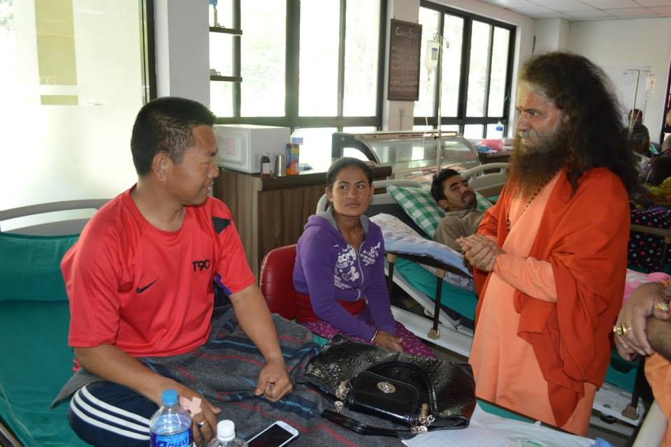 Pujya Swamiji Meets Patients in Nepal (3)